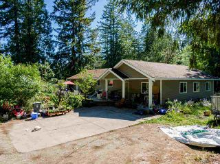 Photo 1: 19860 30 Avenue in Langley: Brookswood Langley House for sale : MLS®# R2590552