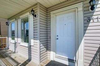 Photo 3: 311 TARALAKE Terrace NE in Calgary: Taradale Detached for sale : MLS®# A1128054