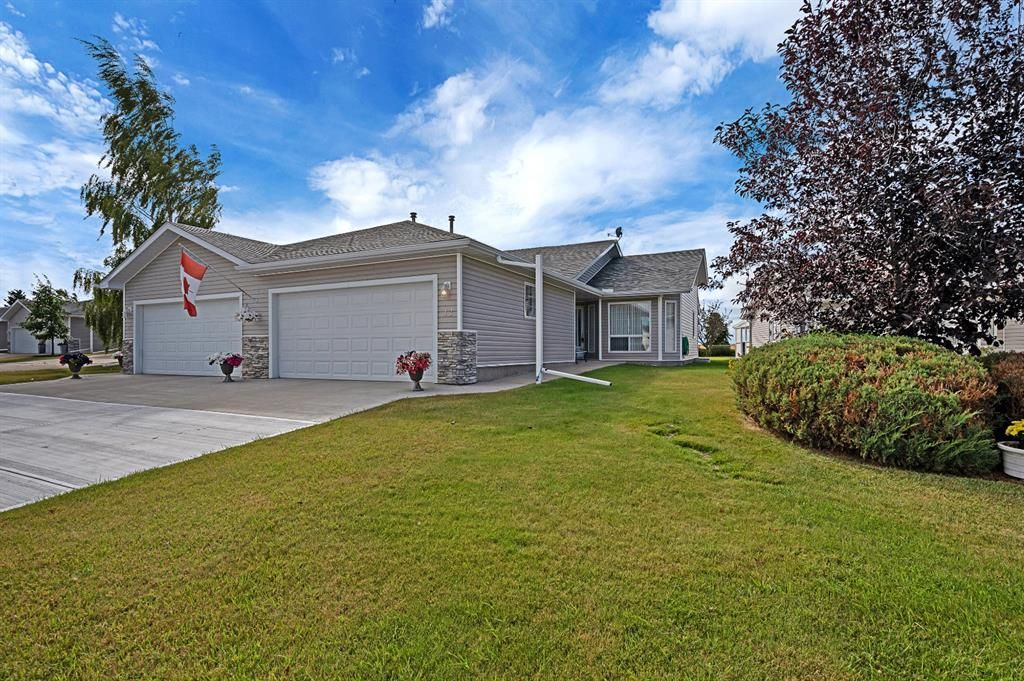 Main Photo: 12 1200 Milt Ford Lane: Carstairs Semi Detached for sale : MLS®# A1031340