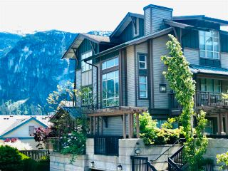 """Photo 1: 201 1174 WINGTIP Place in Squamish: Downtown SQ Townhouse for sale in """"EAGLEWIND TALON CARRIAGE TOWNHOMES"""" : MLS®# R2624425"""