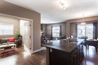 Photo 8: 128 DRAKE LANDING Green: Okotoks House for sale : MLS®# C4167961