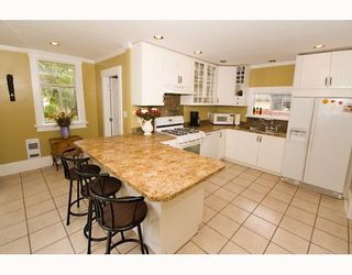 """Photo 6: 1949 ADANAC Street in Vancouver: Grandview VE House for sale in """"COMMERCIAL DRIVE"""" (Vancouver East)  : MLS®# V652514"""