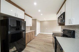 Photo 6: 182 Doverglen Crescent SE in Calgary: Dover Semi Detached for sale : MLS®# A1142371