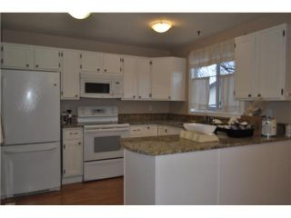 Photo 3: 557 SUMMERWOOD Place SE: Airdrie Residential Attached for sale : MLS®# C3592604