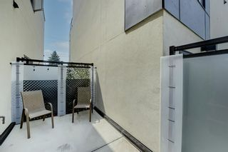 Photo 12: 109 15 Rosscarrock Gate SW in Calgary: Rosscarrock Row/Townhouse for sale : MLS®# A1130892