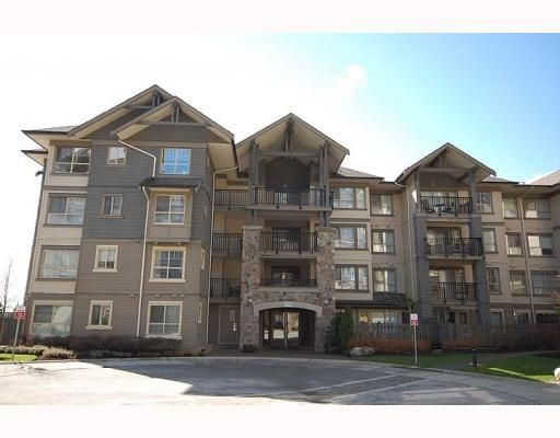 """Main Photo: 204 2958 WHISPER Way in Coquitlam: Westwood Plateau Condo for sale in """"SUMMERLIN"""" : MLS®# V786045"""