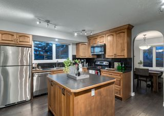 Photo 10: 563 Woodpark Crescent SW in Calgary: Woodlands Detached for sale : MLS®# A1095098