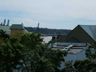 """Photo 1: 402 1065 QUAYSIDE Drive in New Westminster: Quay Condo for sale in """"QUAYSIDE TOWER II"""" : MLS®# V1008499"""