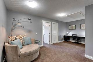 Photo 17: 212 QUARRY PARK Boulevard SE in Calgary: Douglasdale/Glen Row/Townhouse for sale : MLS®# A1095917