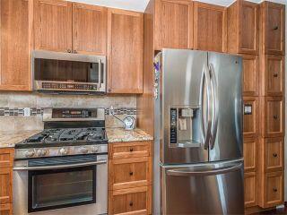 Photo 6: 126 OAKMOOR Place SW in Calgary: Oakridge House for sale : MLS®# C4101337