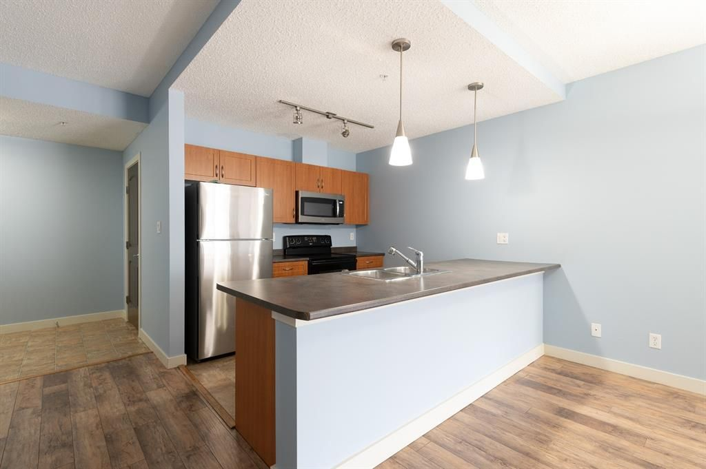 The large kitchen features large breakfast bar & lots of counter space.