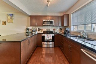 Photo 14: 203 River Heights Green: Cochrane Detached for sale : MLS®# A1145200