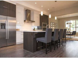 Photo 6: 459 21 Avenue NW in CALGARY: Mount Pleasant Residential Attached for sale (Calgary)  : MLS®# C3584412