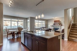 Photo 10: 209 HERITAGE Boulevard: Cochrane House for sale : MLS®# C4172934