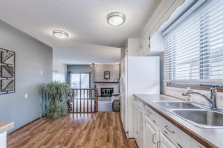 Photo 8: 8 Edgeland Bay NW in Calgary: Edgemont Detached for sale : MLS®# A1103011