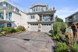 """Photo 1: 828 PARKER Street: White Rock House for sale in """"EAST BEACH"""" (South Surrey White Rock)  : MLS®# R2607727"""