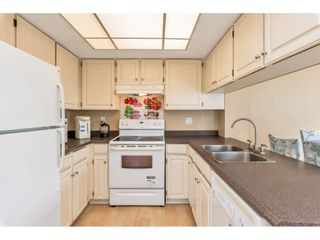 """Photo 2: 3117 SADDLE Lane in Vancouver: Champlain Heights Townhouse for sale in """"HUNTINGWOOD"""" (Vancouver East)  : MLS®# R2469086"""