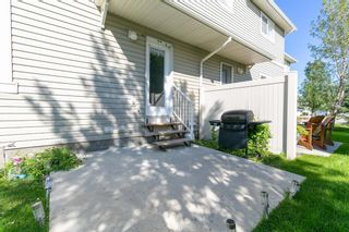 Photo 28: 58 Arbours Circle NW: Langdon Row/Townhouse for sale : MLS®# A1137898