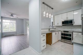 """Photo 4: 216 13277 108 Avenue in Surrey: Whalley Condo for sale in """"Pacifica"""" (North Surrey)  : MLS®# R2472406"""