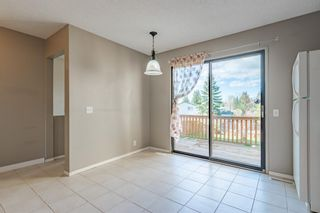 Photo 7: 6408 RANCHVIEW Drive NW in Calgary: Ranchlands Row/Townhouse for sale : MLS®# A1107024