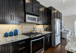 Photo 5: 106 1312 Russell Road NE in Calgary: Renfrew Row/Townhouse for sale : MLS®# A1080835