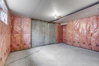 Photo 25: 1401 281 COUGAR RIDGE Drive SW in Calgary: Cougar Ridge Row/Townhouse for sale : MLS®# A1070231