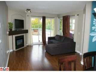 """Photo 3: 108 20125 55A Avenue in Langley: Langley City Condo for sale in """"BLACKBERRY LANE 2"""" : MLS®# F1200974"""
