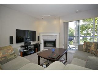 """Photo 3: 207 20277 53 Avenue in Langley: Langley City Condo for sale in """"Metro II"""" : MLS®# F1446990"""