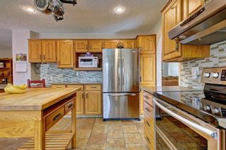 Photo 4: 153 SHAWNEE Court SW in Calgary: Shawnee Slopes Detached for sale : MLS®# C4242330