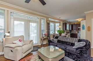 """Photo 9: 34745 3RD Avenue in Abbotsford: Poplar House for sale in """"HUNTINGDON VILLAGE"""" : MLS®# R2580704"""