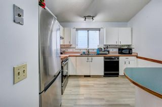 Photo 10: 27 Martinwood Road NE in Calgary: Martindale Detached for sale : MLS®# A1095419