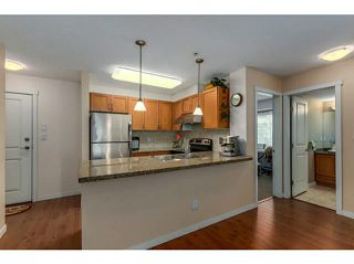 """Photo 2: 108 2373 ATKINS Avenue in Port Coquitlam: Central Pt Coquitlam Condo for sale in """"CARMANDY"""" : MLS®# V1136914"""
