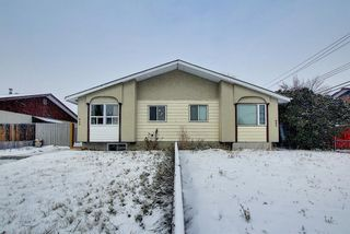 Photo 1: 929 Marcombe Drive NE in Calgary: Marlborough Semi Detached for sale : MLS®# A1043731