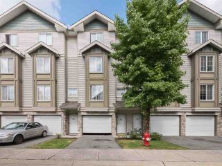 "Photo 1: 24 14855 100 Avenue in Surrey: Guildford Townhouse for sale in ""Bloomsbury Court"" (North Surrey)  : MLS®# R2532213"