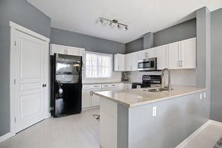 Photo 17: 504 281 Cougar Ridge Drive SW in Calgary: Cougar Ridge Row/Townhouse for sale : MLS®# A1123514