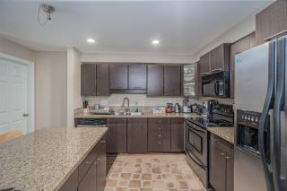 """Photo 1: 205 5488 198 Street in Langley: Langley City Condo for sale in """"BROOKLYN WYND"""" : MLS®# R2516608"""