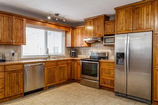 Photo 9: 608 Willacy Drive SE in Calgary: Willow Park Detached for sale : MLS®# A1050257