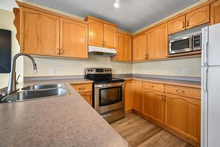 Photo 4: 154 Bridleglen Road SW in Calgary: Bridlewood Detached for sale : MLS®# A1113025
