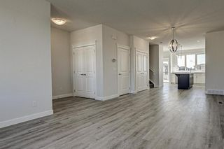 Photo 5: 132 Creekside Drive SW in Calgary: C-168 Semi Detached for sale : MLS®# A1098272