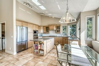 Photo 14: 555 Coach Light Bay SW in Calgary: Coach Hill Detached for sale : MLS®# A1144688