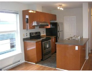"Photo 2: 306 1688 E 8TH Avenue in Vancouver: Grandview VE Condo for sale in ""LA RESIDENZA"" (Vancouver East)  : MLS®# V743696"