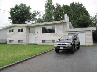 "Photo 1: 10018 KILLARNEY Drive in Chilliwack: Fairfield Island House for sale in ""FAIRFIELD ISLAND"" : MLS®# R2344062"
