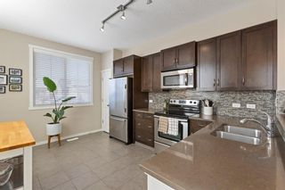 Photo 9:  in Calgary: Evanston Row/Townhouse for sale : MLS®# A1073817