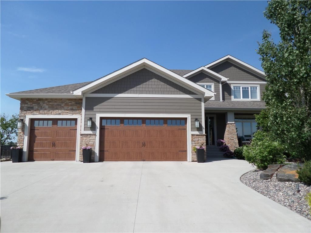 169 Saddleridge Lane, Countryside Crossing in East St Paul. Professionally landscaped by Silverstone.