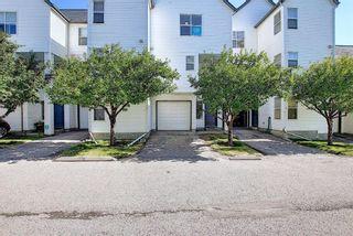 Photo 2: 25 200 HIDDEN HILLS Terrace in Calgary: Hidden Valley Row/Townhouse for sale : MLS®# A1022696
