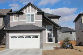 Photo 1: 912 PRAIRIE SPRINGS Drive SW: Airdrie Residential Detached Single Family for sale : MLS®# C3512695