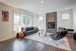 Photo 7: 127 Springbluff Boulevard SW in Calgary: Springbank Hill Detached for sale : MLS®# A1140601