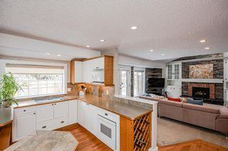 Photo 11: 704 Willingdon Boulevard SE in Calgary: Willow Park Detached for sale : MLS®# A1070574