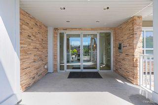 "Photo 4: 101 6490 194 Street in Surrey: Clayton Condo for sale in ""Waterstone"" (Cloverdale)  : MLS®# R2601636"