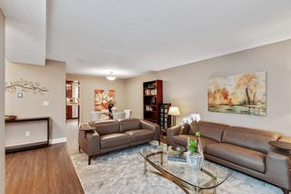 """Photo 6: 8215 STRAUSS Drive in Vancouver: Champlain Heights Townhouse for sale in """"Ashleigh Heights"""" (Vancouver East)  : MLS®# R2565596"""